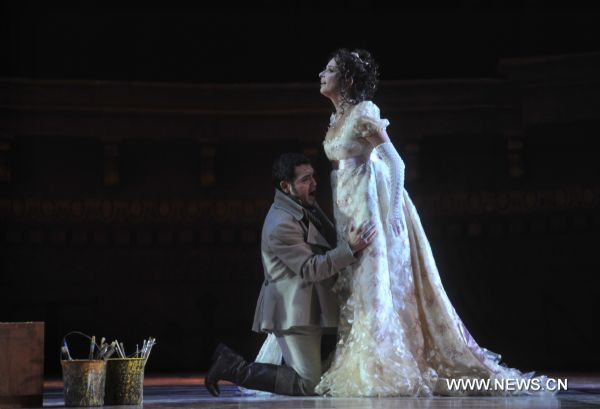 Tosca, Act I, with Aquiles Machado as Mario and Nicola Beller Carbone as Tosca.